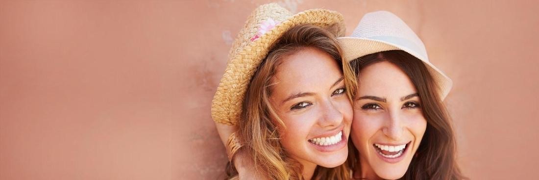 Two women smiling | Dentist Aurora IL