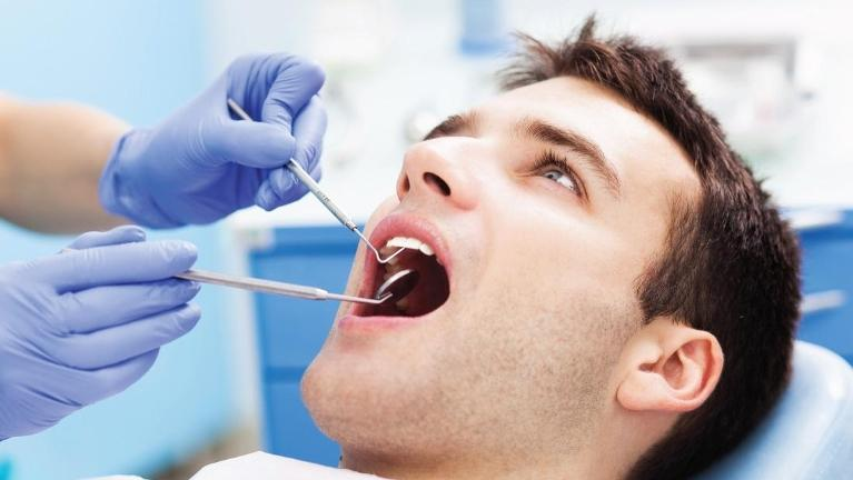 Man at Emergency Dental Appointment in Aurora IL