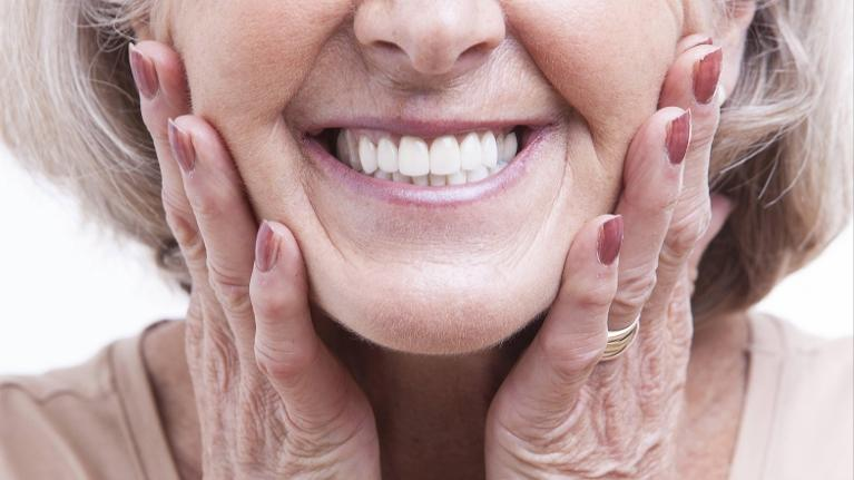 Woman Smiling with dental implants in aurora il