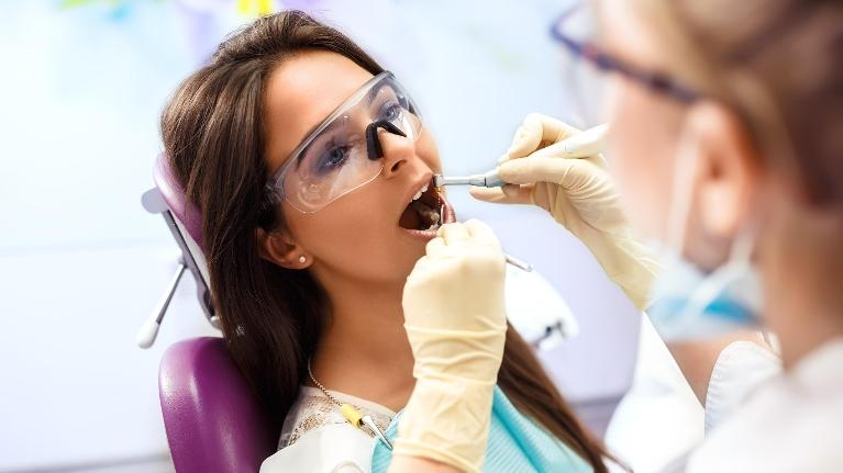 woman getting dental cleaning